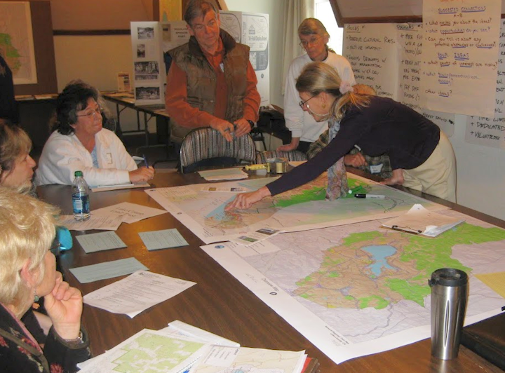 Photo of KRT Volunteers discussing trail routes