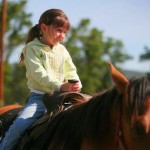 Child riding horse at Owen Ranch, Middletown, CA
