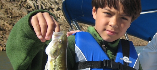 Photo of child with bass