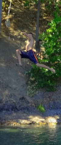 Photo of kid jumping off rope swing in Blue Lakes, Lake County, CA