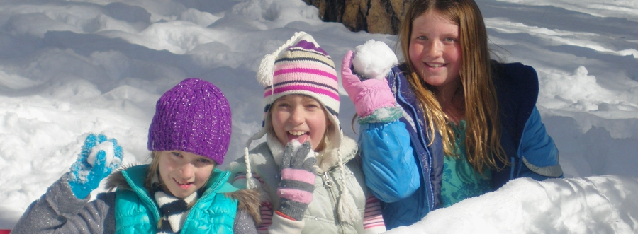 Photo of kids playing in the snow on Boggs Mountain Demonstration State Forest