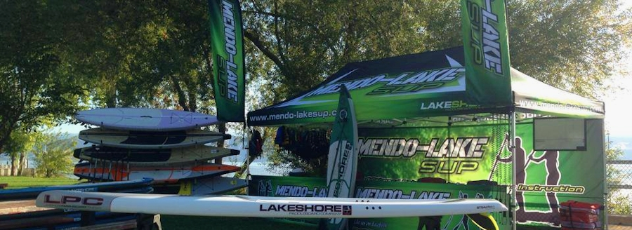 Photo of Mendo-Lake SUP sales booth with stand up paddleboards in Lake County, CA